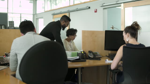 Four people working in an office