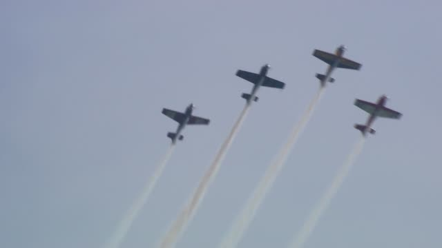 four planes fly in formation at the chicago air and water show on august 17, 2014 in chicago, illinois. - chicago air and water show stock videos & royalty-free footage