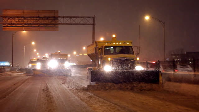four plows are scraping a highway - snowplough stock videos & royalty-free footage