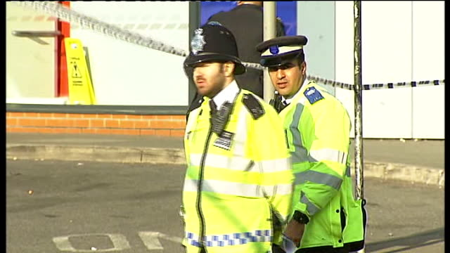 suspect appears in court england north london kingsbury ext various shots of crime scene police officers cordoned road police vest on ground forensics - 登場点の映像素材/bロール
