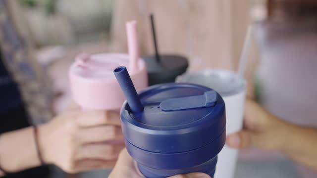 pov four reusable travel mugs cheers - reusable stock videos & royalty-free footage