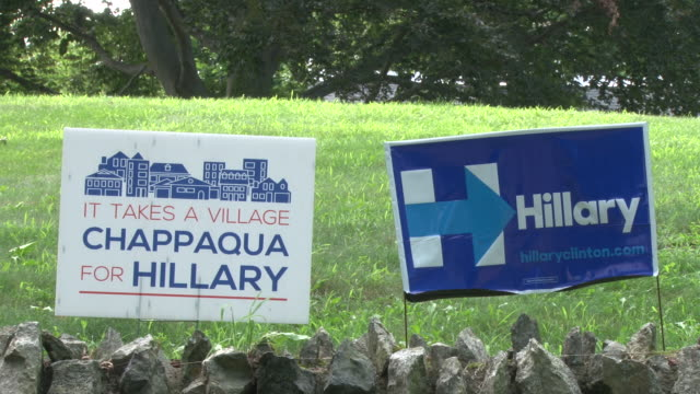 stockvideo's en b-roll-footage met four roadside signs supporting hillary clinton's campaign for president of the united states / one sign reads it takes a village chappaqua for... - kant van de weg