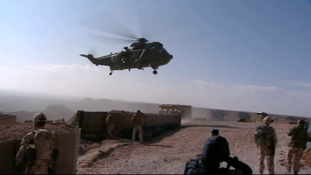 four royal marines killed / gordon brown visit helmand camp bastion army cobra helicopter in flight pull as seen beyond barrel of gun on helicopter... - union army stock videos & royalty-free footage