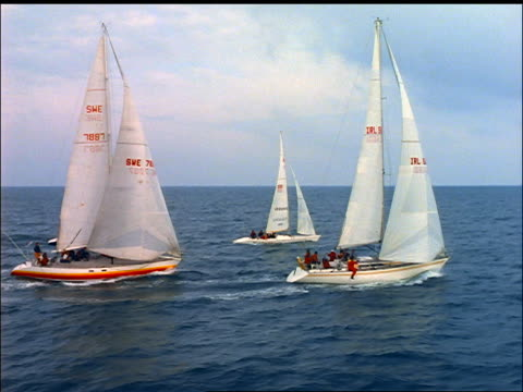 aerial four sailboats racing on ocean / kinsale harbour, county cork, ireland - county cork stock videos & royalty-free footage