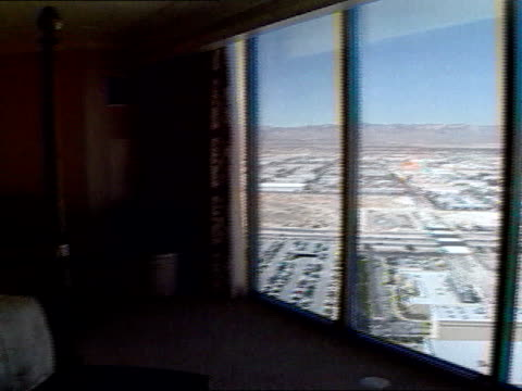 four seasons hotel suite from window of high floor bedroom suite, sierra nevada mountains in distance to bed. - bay window stock videos & royalty-free footage
