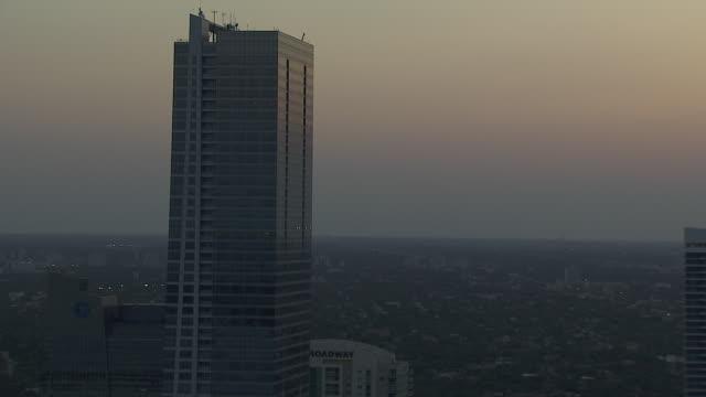 four seasons hotel & tower, city buildings, sky w/ orange tint bg. urban, skyscraper. - four seasons hotel stock videos & royalty-free footage