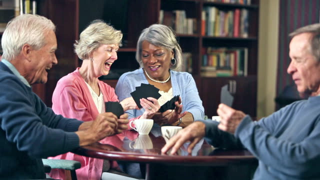 four seniors drinking coffee, playing card game - playing card stock videos & royalty-free footage
