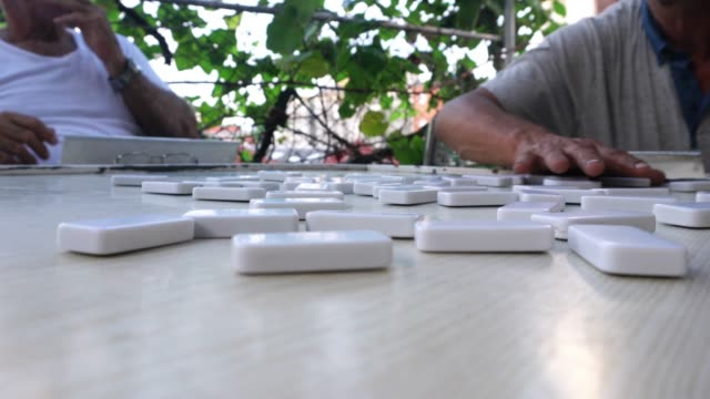 four seniors mature cuban man playing domino outdoor patio havana - havana stock videos & royalty-free footage