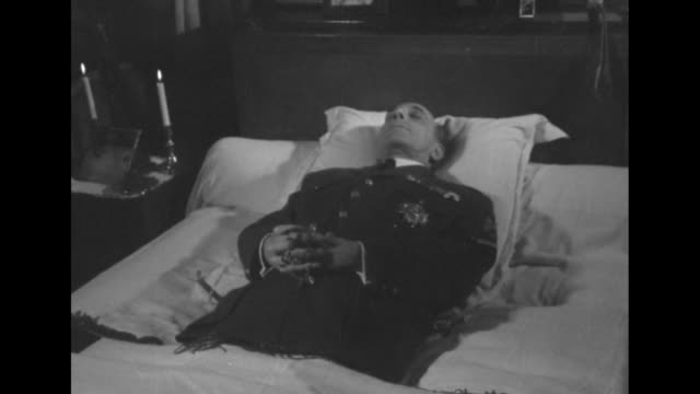 stockvideo's en b-roll-footage met four shots of french gen jean de lattre de tassigny lying in state in bed at home / line of mourners climbing steps to view body/ crowd of mourners... - opgebaard liggen