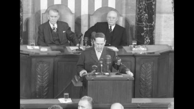 four shots of gen douglas macarthur standing at rostrum in house chamber speaking about humility pride he commends congress he discusses communist... - humility stock videos and b-roll footage