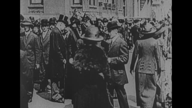 Four shots of men and women walking up and down Fifth Avenue during Easter Parade / people walking up and down Fifth Avenue during Easter Parade /...