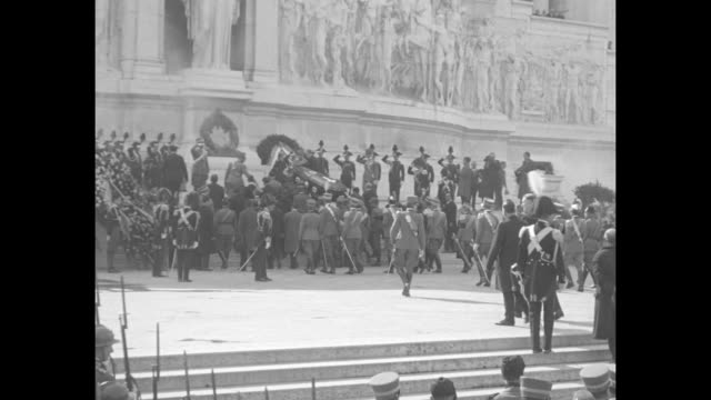 four shots of men carrying marshal armando diaz's casket up steps to victor emmanuel ii monument followed by funeral procession / overhead shot of... - piazza venezia stock videos and b-roll footage
