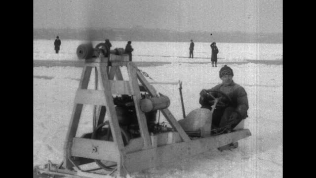 Four shots of people driving propellerdriven ice boats on frozen lake / crowd of people standing in circle around man doing figure skating routine on...