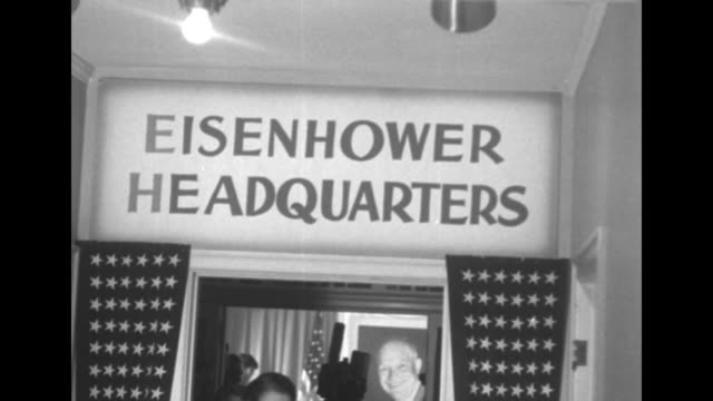 vídeos de stock, filmes e b-roll de four shots of people walking back and forth through doorway in dwight eisenhower election headquarters with sign over it that reads eisenhower... - eleição primária