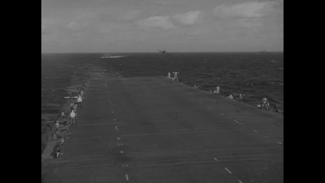 Four shots of planes landing on aircraft carrier / two shots of planes taking off from aircraft carrier at dusk / two shots of planes massed on deck...