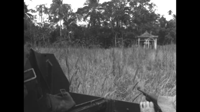 vídeos de stock, filmes e b-roll de four shots of soldiers firing machine guns on amphibious vehicles / close view of soldier talking on radio in amphibious vehicle / close view of... - veículo anfíbio