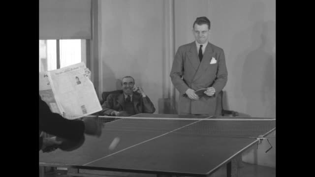 four shots of two executives playing ping pong two other executives sitting and watching / two men push cart across lobby towards elevator / same two... - push cart stock videos and b-roll footage