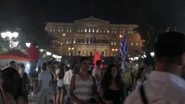 four shots showing people at syntagma square on the night that the referendum results over bailout terms were announced front view of greek... - ユーロ圏債務危機点の映像素材/bロール