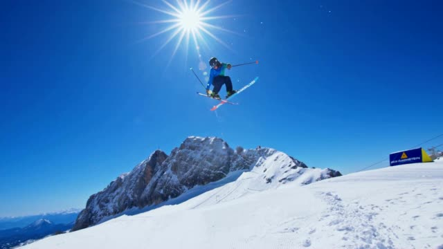 four slow motion shots of skiers and snowboarder making acrobatic jumps over the kicker in the snowpark.. no audio - freistil skifahren stock-videos und b-roll-filmmaterial