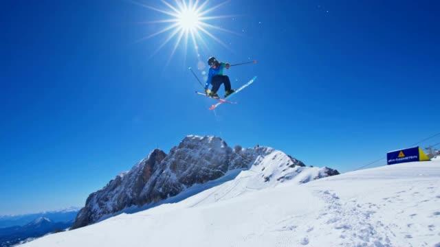 four slow motion shots of skiers and snowboarder making acrobatic jumps over the kicker in the snowpark no - freestyleskidåkning bildbanksvideor och videomaterial från bakom kulisserna