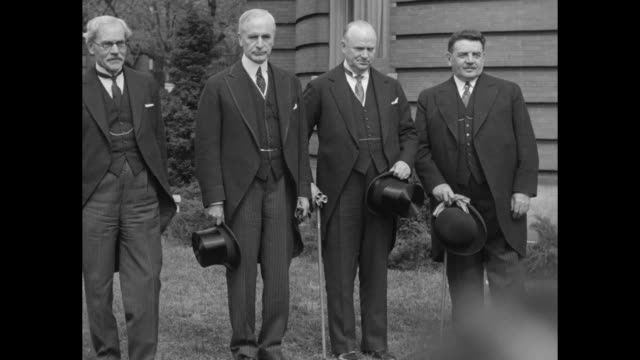 four statesmen standing outdoors together for photo opportunity holding hats and gloves l to r uk prime minister ramsay macdonald us secretary of... - cordell hull stock videos and b-roll footage