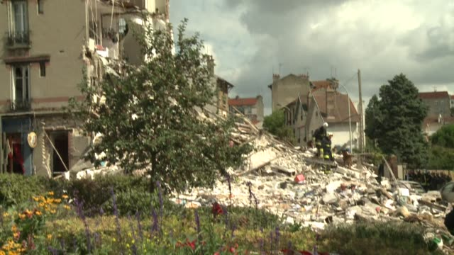 A four storey residential building collapsed on Sunday morning in a Paris suburb following an explosion killing at least one child and injuring 11...