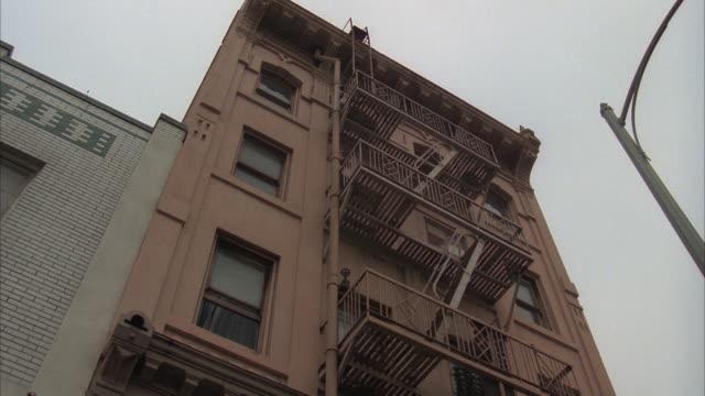 la, four story apartment building wit fire escape - fire escape stock videos and b-roll footage
