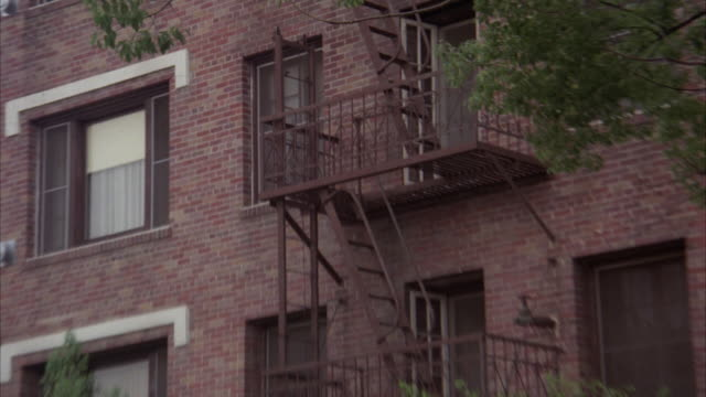 MS ZI Four story brick apartment building with canopy and fire escape out at front