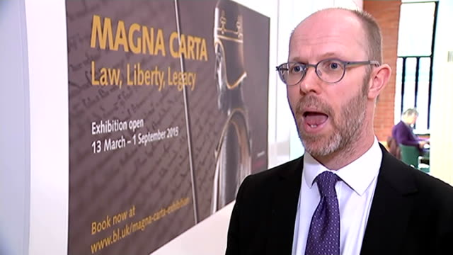 vídeos de stock e filmes b-roll de four surviving copies of the magna carta go on display at the british library; london: british library: int julian harrison interview sot - magna carta documento histórico