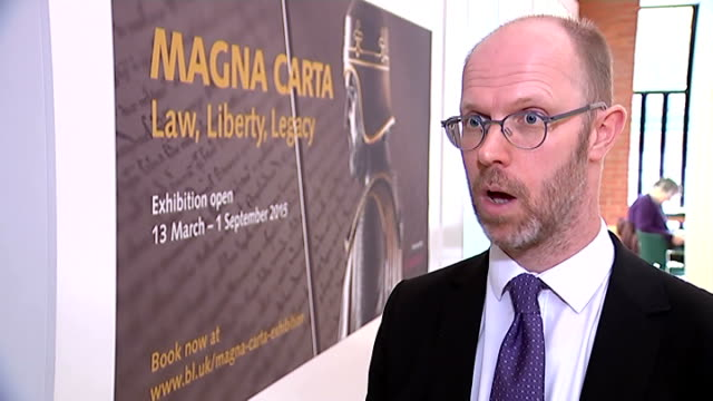 vídeos de stock e filmes b-roll de four surviving copies of the magna carta go on display at the british library; julian harrison interview sot - magna carta documento histórico