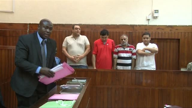 vídeos de stock e filmes b-roll de four suspected top drug traffickers in kenya awaiting extradition to the united states appeared in court tuesday where they were remanded in custody... - símbolo ortográfico