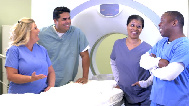 four technologists with cat scan machine - radiographer stock videos & royalty-free footage