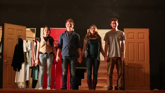 stockvideo's en b-roll-footage met four teenage actors bowing at the conclusion of a theater performance - theater