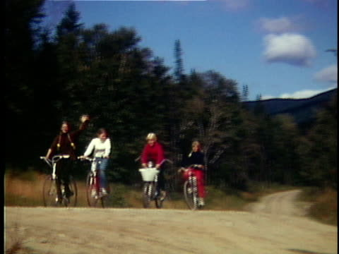 1965 WS Four teenage girls riding bicycle on rural road, Vermont, Canada