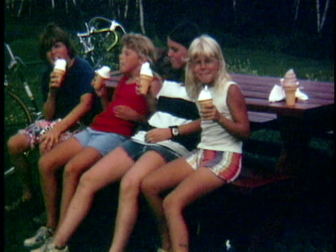 1972 ms four teenagers eating ice cream at picnic table, bristol, vermont, usa - 1972 stock videos and b-roll footage