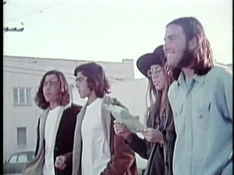 vídeos de stock, filmes e b-roll de 1973 ms four teenagers walking outdoors, los angeles, california, usa / audio - 1973