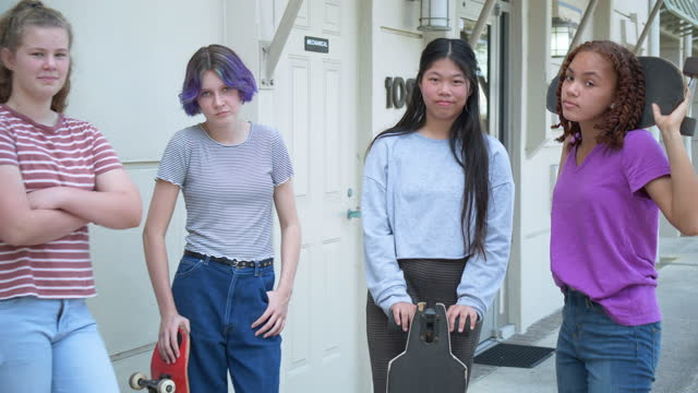four tween girls hang out on sidewalk with skateboards - 12 13 years stock videos & royalty-free footage