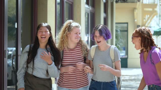 four tween girls walking on sidewalk, laughing, pushing - 12 13 years stock videos & royalty-free footage