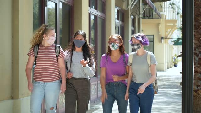 four tween girls walking on sidewalk, wearing masks - 12 13 years stock videos & royalty-free footage