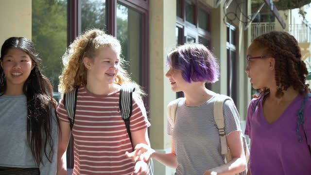 four tween girls walking, talking on sidewalk, laughing - 12 13 years stock videos & royalty-free footage