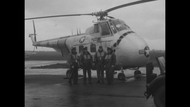four us air force men wearing life vests stand in front of a helicopter; the men rescued the lone survivor of the south goodwin lightship disaster... - lightship stock videos & royalty-free footage