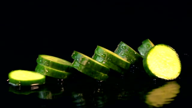four videos of falling cucumber in real slow motion - pickled stock videos and b-roll footage