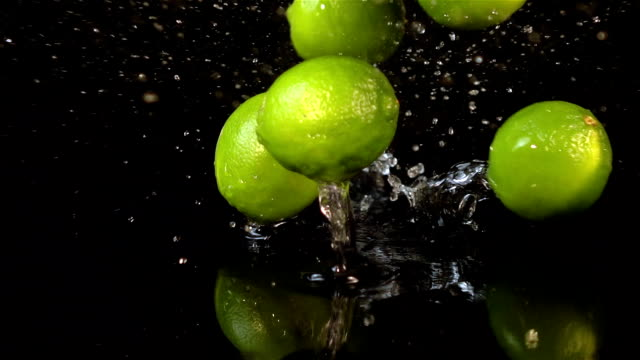 four videos of falling lime in real slow motion - lime stock videos and b-roll footage