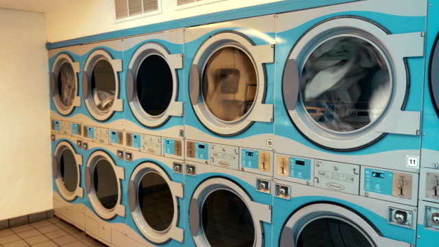four videos of self-service laundry - coin wash - laundromat stock videos & royalty-free footage
