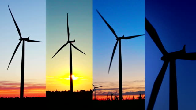 four wind turbines at sunset - four objects stock videos & royalty-free footage