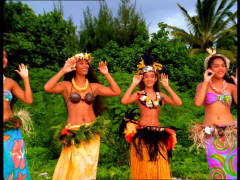 four women in bikini tops and sarongs hula dance on the beach. - fiji stock videos & royalty-free footage