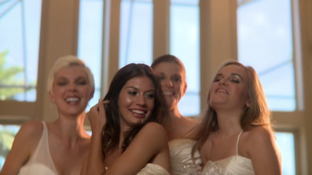 slo mo cu four women in wedding dresses laughing and dancing, jacksonville, florida, usa - wedding reception stock videos and b-roll footage