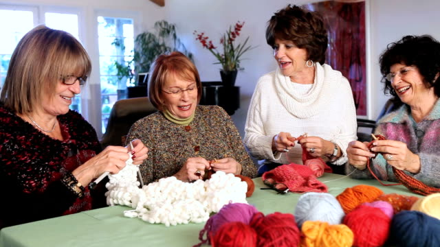 ms pan four women knitting and enjoying themselves / los angeles, california, usa - stricken stock-videos und b-roll-filmmaterial
