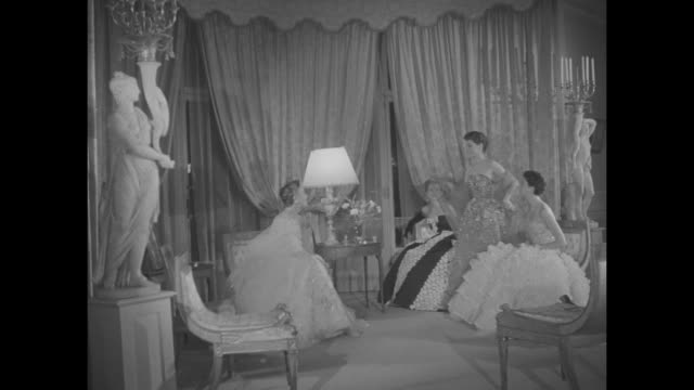 four women model evening gowns / 3 women in cocktail dresses and hats one holds a puppy / evening gowns / cu gown's detailed sparkling sequin pattern... - sequin stock videos & royalty-free footage