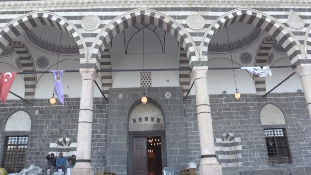 four years after it was gutted by a fire set by pkk terrorists a historic mosque in southeastern turkey will reopen for worship on thursday... - four objects stock videos & royalty-free footage